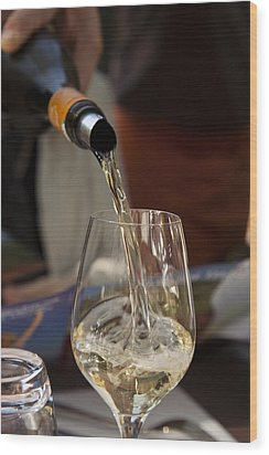 A Glass Of White Wine Being Poured Wood Print by Taylor S. Kennedy