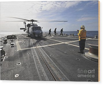 A Helicpter Sits On The Flight Deck Wood Print by Stocktrek Images