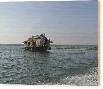 A Houseboat Moving Placidly Through A Coastal Lagoon In Alleppey Wood Print by Ashish Agarwal