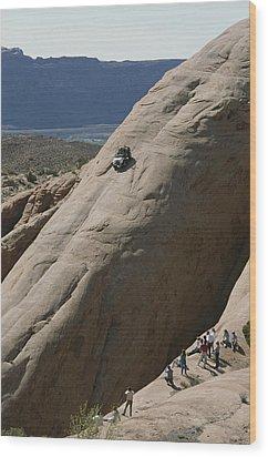A Jeep Drives Down A Slick Rock Wood Print by James P. Blair