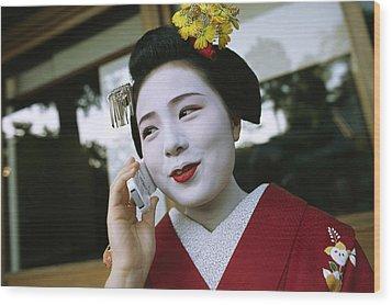 A Kimono-clad Geisha Talks On A Cell Wood Print by Justin Guariglia