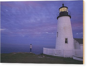 A Lighthouse Visitor Enjoys A Twilight Wood Print by Stephen St. John