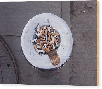 A Lot Of Cigarettes Stubbed Out At A Garbage Bin Wood Print by Ashish Agarwal