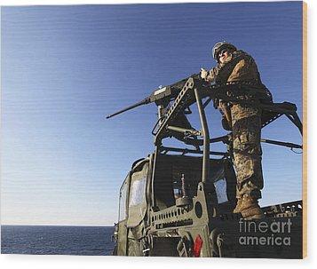 A Machine Gunner Mounts A M-2 Wood Print by Stocktrek Images