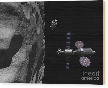 A Manned Maneuvering Vehicle Descends Wood Print by Walter Myers