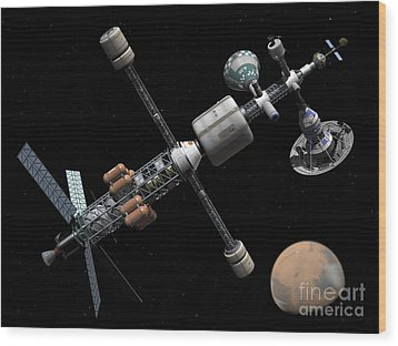 A Manned Mars Cycler Space Station Wood Print by Walter Myers