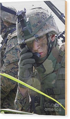 A Marine Communicates Over The Radio Wood Print by Stocktrek Images