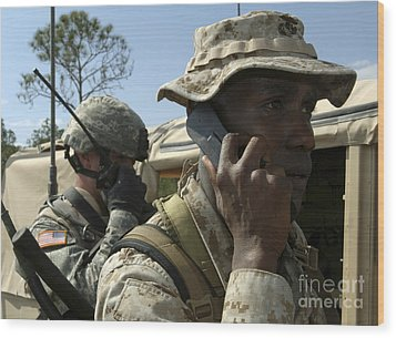 A Marine Communicates With Aircraft Wood Print by Stocktrek Images