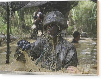 A Marine Splashes As He Makes His Way Wood Print by Stocktrek Images