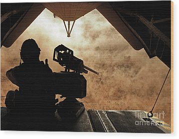 A Marine Waits For Dust To Clear While Wood Print by Stocktrek Images