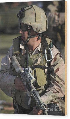 A Military Reserve Navy Seal Kneels Wood Print by Michael Wood