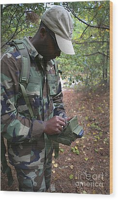 A Military Technician Uses A Pda Wood Print by Michael Wood