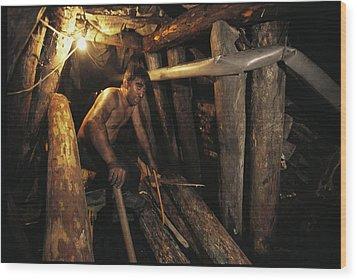 A Miner Works His Way Through A Jumble Wood Print by Randy Olson