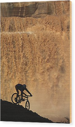 A Mountain Biker Pedals Past Rushing Wood Print by Bill Hatcher