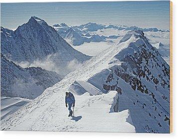 A Mountaineer On The Summit Ridge Wood Print by Gordon Wiltsie