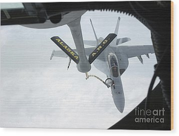 A Navy Fa-18f Super Hornet Is Refueled Wood Print by Stocktrek Images