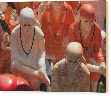 A Number Of Statues Of The Shirdi Sai Baba For Sale At Surajkund Mela Wood Print by Ashish Agarwal