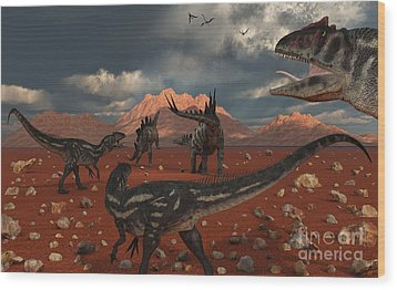 A Pack Of Allosaurus Dinosaurs Track Wood Print by Mark Stevenson