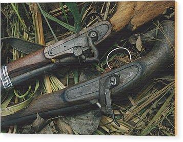 A Pair Of Old Flint-type Rifles Lying Wood Print by Steve Winter