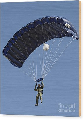 A Paratrooper Descends Through The Sky Wood Print by Stocktrek Images