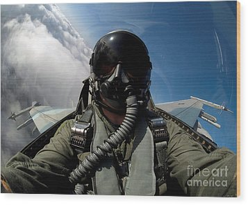 A Pilot In The Cockpit Of An F-16 Wood Print by Stocktrek Images