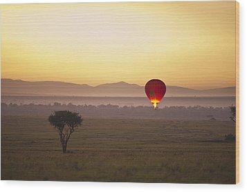 A Red Hot Air Balloon Takes Flight Wood Print by David DuChemin
