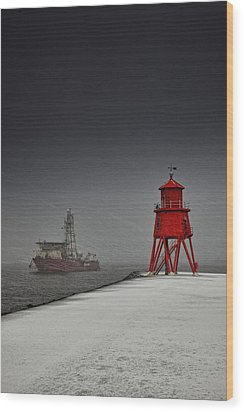 A Red Lighthouse Along The Coast In Wood Print by John Short