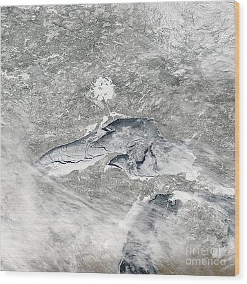 A Relatively Rare Blanket Of Ice Rests Wood Print by Stocktrek Images