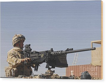 A Royal Marine Manning A .50 Caliber Wood Print by Andrew Chittock