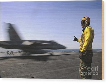 A Sailor Ensures An Fa-18c Hornet Wood Print by Stocktrek Images