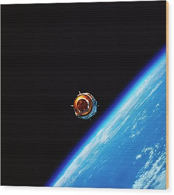 A Satellite In Orbit Above Earth Wood Print by Stockbyte