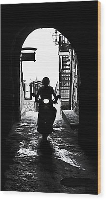 a scooter rider in the back light in a narrow street in Italy Wood Print by Joana Kruse