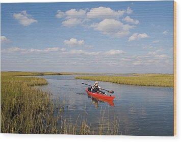 A Sea Kayaker And Fisherman Paddles Wood Print by Skip Brown