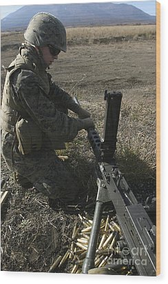 A Soldier Changes The Barrel Of An M2 Wood Print by Stocktrek Images