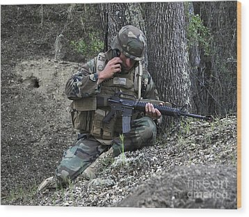 A Soldier Communicates His Position Wood Print by Stocktrek Images