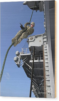 A Soldier Fast-ropes From The Rear Wood Print by Stocktrek Images