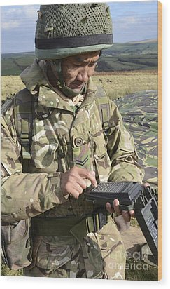 A Soldier Inputs The Firing Data Wood Print by Andrew Chittock