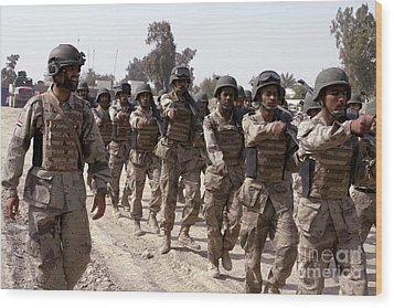 A Soldier Marches His Troops Wood Print by Stocktrek Images