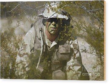 A Soldier Practices Evasion Maneuvers Wood Print by Stocktrek Images