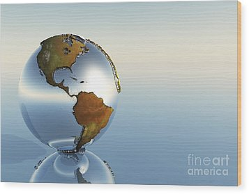 A Sphere Holding North And South Wood Print by Corey Ford