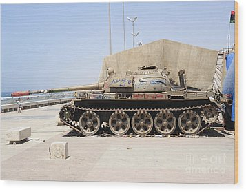 A T-55 Tank On The Seafront Wood Print by Andrew Chittock