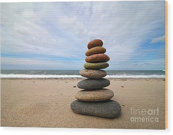 A Tower Of Stones On The Beach Wood Print by Holger Ostwald