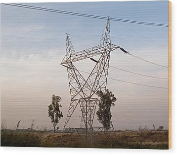 A Transmission Tower Carrying Electric Lines In The Countryside Wood Print by Ashish Agarwal