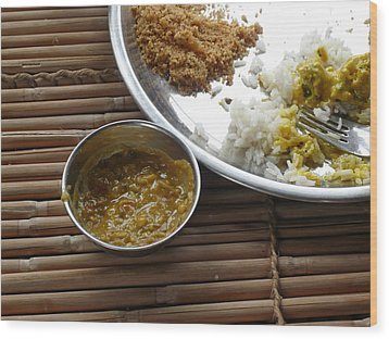 A Typical Plate Of Indian Rajasthani Food On A Bamboo Table Wood Print by Ashish Agarwal