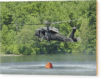 A Uh-60 Blackhawk Helicopter Fills Wood Print by Stocktrek Images