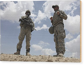 A U.s. Army Soldier Communicates Wood Print by Stocktrek Images