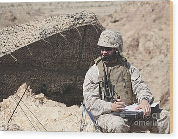 A U.s. Marine Communicates With Close Wood Print by Stocktrek Images