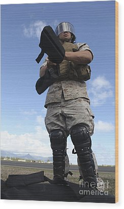 A U.s. Marine Dons Riot Gear For Drills Wood Print by Stocktrek Images