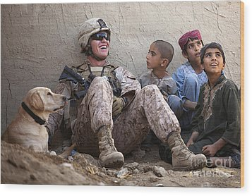 A U.s. Marine Jokes With Afghan Wood Print by Stocktrek Images