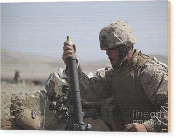 A U.s. Marine Loads A Mortar Wood Print by Stocktrek Images